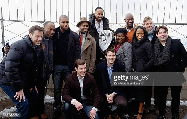 'Book Of Mormon' cast member Christopher John O'Neill Nikki Renee Daniels and Nic Rouleau light The Empire State Building in celebration of their 5th...
