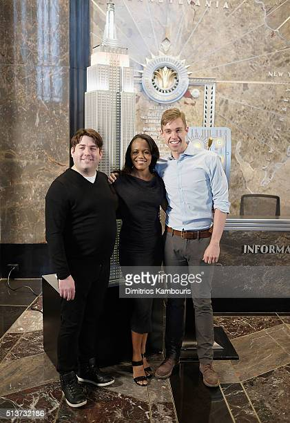 4 'Book Of Mormon' cast members Christopher John O'Neill Nikki Renee Daniels and Nic Rouleau light The Empire State Building in celebration of their...
