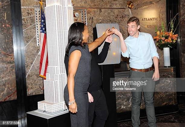 Book Of Mormon' Cast with members Nikki Renee Daniels, Christopher John O'Neill and Nic Rouleau light The Empire State Building in celebration of...
