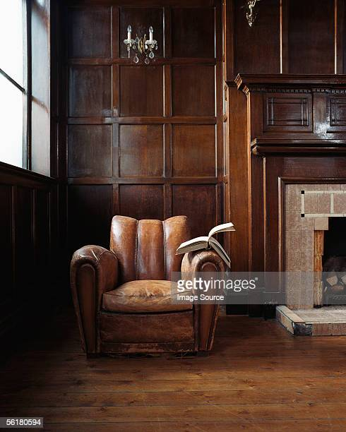 book on a leather armchair - chair stock pictures, royalty-free photos & images