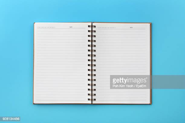 book on blue background - personal organiser stock pictures, royalty-free photos & images