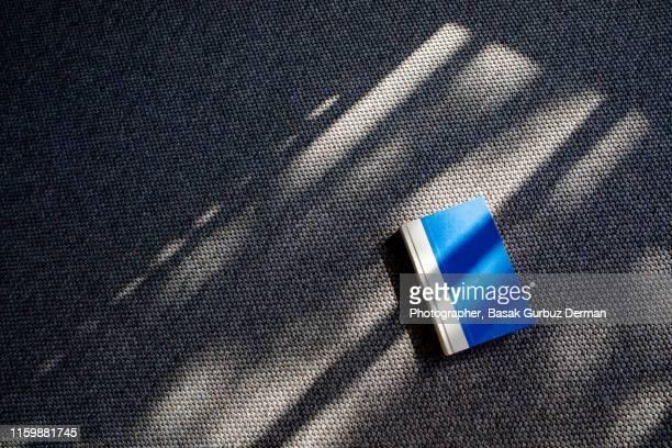 book on the carpet - basak gurbuz derman stock photos and pictures