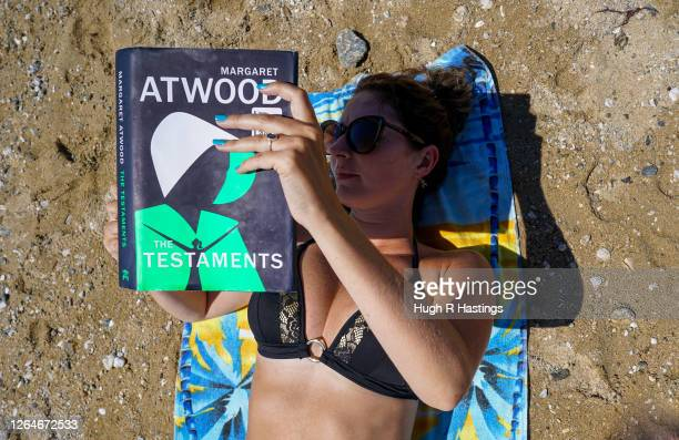 A book reader relaxes in the sun on Gyllyngvase Beach on August 8 2020 in Falmouth Cornwall England The RNLI has called on beachgoers in the south...