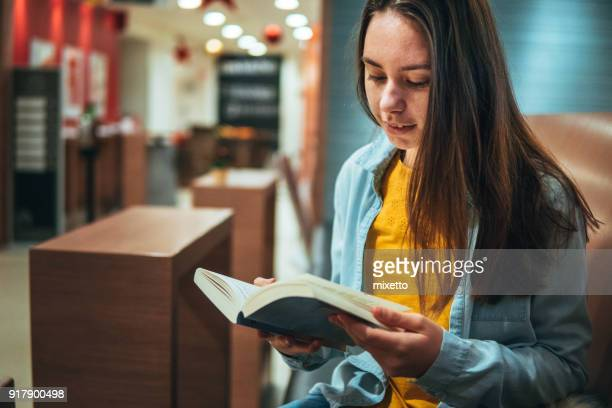 book reading in coffee shop - literature stock pictures, royalty-free photos & images