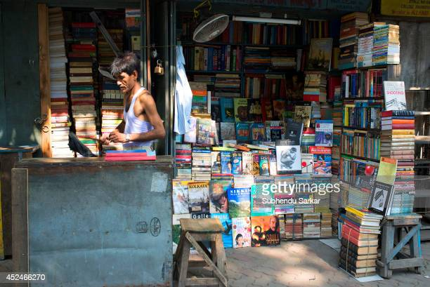 A book seller at his book stall along the pavement of college street book market in Kolkata This book market is half a mile long in an area in...