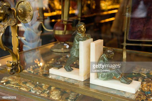 Book stands in SaintOuen flea market on February 8 outside Paris France The Paris Flea Market opened in 1885 Located in a popular district it extends...
