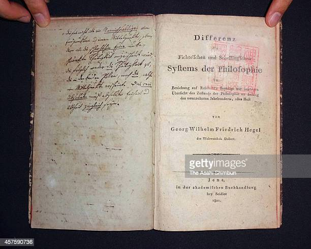 A book with a handwritten note by German philosopher Georg Wilhelm Friedrich Hegel The Difference Between Fichte's and Schelling's Systems of...