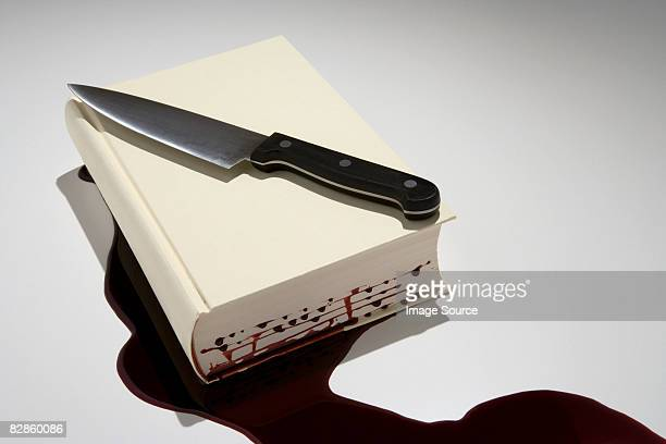a book with blood dripping out of it - crime and murder stock pictures, royalty-free photos & images