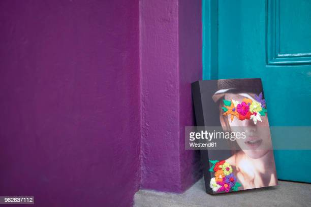 Book with face of a woman leaning on door