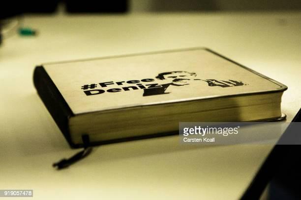A book with the title #FreeDeniz lies on a desk in the Die Welt newsroom following the release of Die Welt journalist Deniz Yucel from a Turkish...