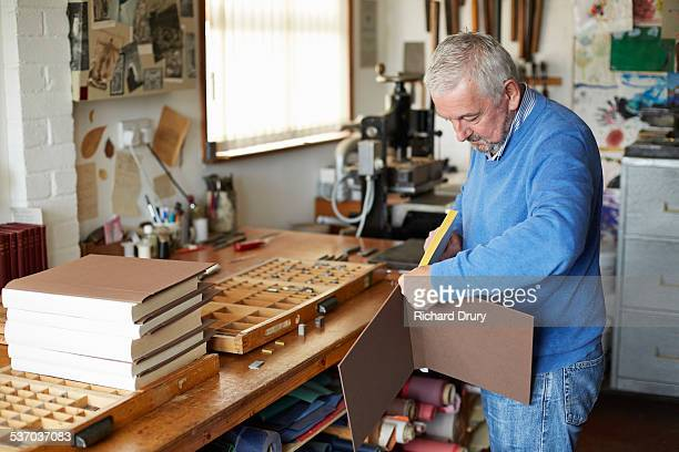 Bookbinder fitting book into case