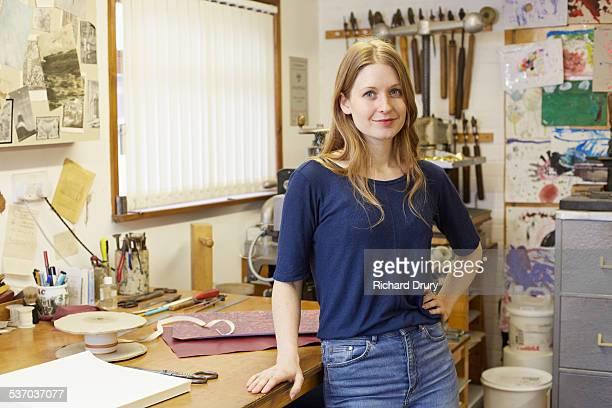 Bookbinder in her workshop