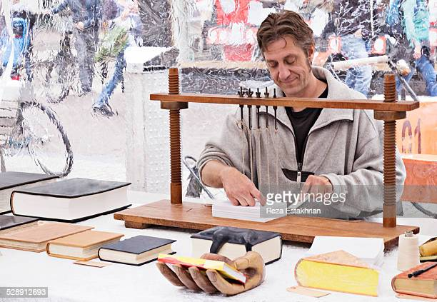 Bookbinding at an outside market