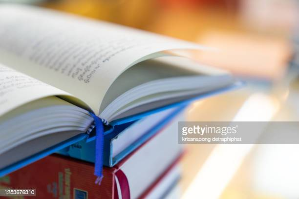 book,book stack in the library room,education concept - publication stock pictures, royalty-free photos & images