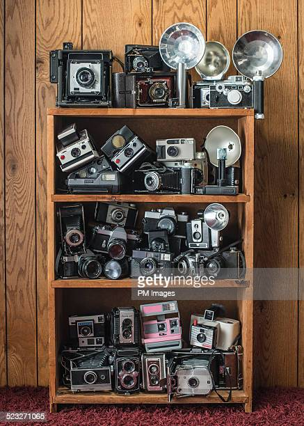 Bookcase with many vintage cameras