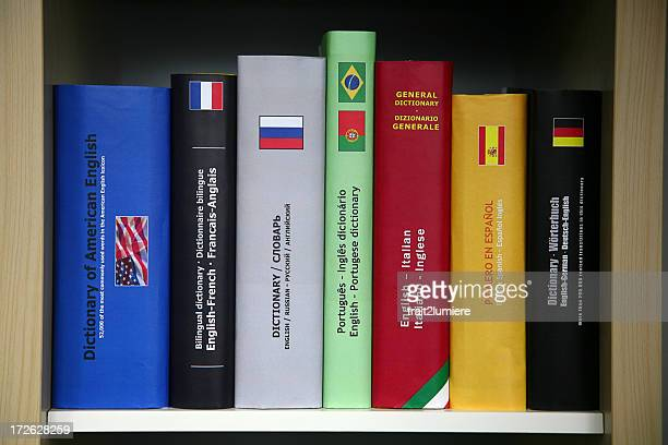 bookcase with numerous foreign languages dictionaries. - spanish culture stock pictures, royalty-free photos & images