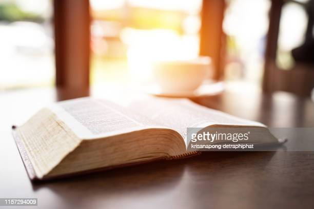 a book,education,holy bible - bible stock pictures, royalty-free photos & images