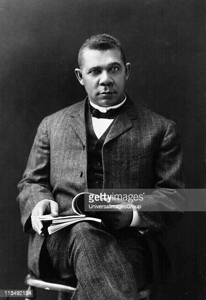 Booker T Washington African American educator and Civil Rights leader Photographic portrait of Booker seated and holding a open book