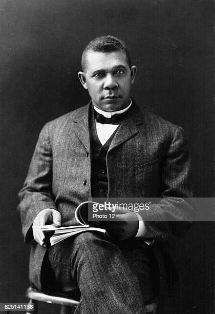 Booker T Washington African American educator and Civil Rights leader Booker seated and holding a open book
