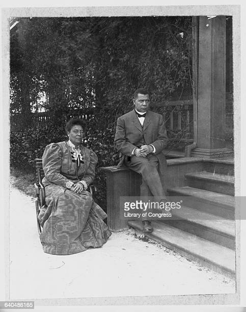 Booker T Washington and wife Margaret Murray Washington sit on a porch