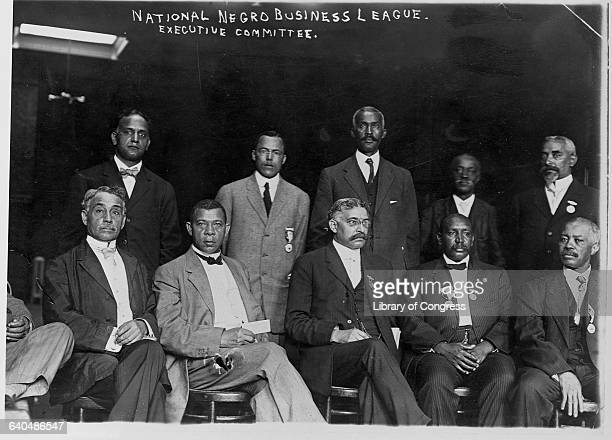 Booker T Washington poses with other members of the National Negro Business League Executive Committee