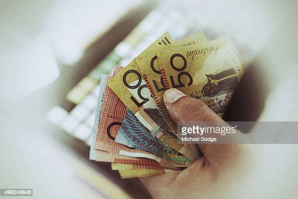 A bookie counts his money during the Melbourne Spring Racing Carnival at Flemington Racecourse on November 7 2015 in Melbourne Australia