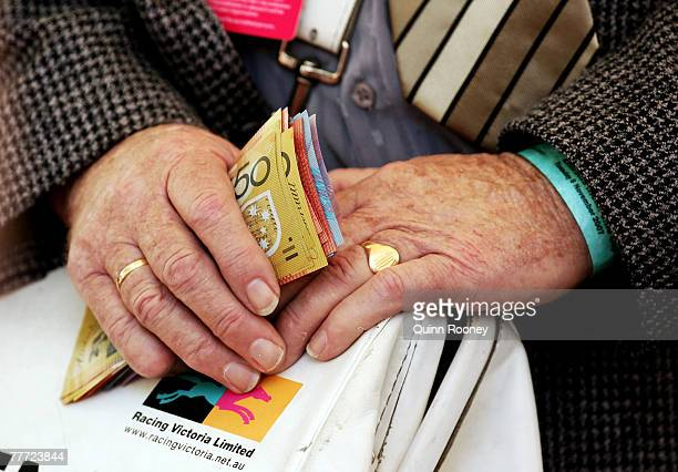 A bookie holds money at The Melbourne Cup Carnival meeting at Flemington Racecourse November 6 2007 in Melbourne Australia
