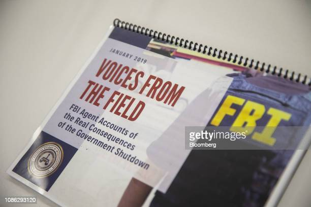 A booklet containing testimonies on how the government shutdown is impacting Federal Bureau of Investigation  Agents sits on a table during a news...