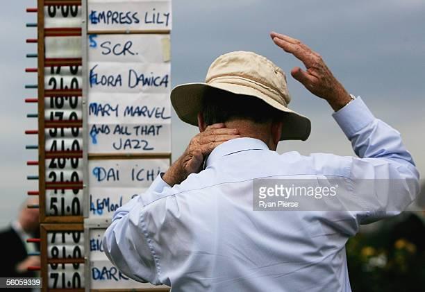 A bookmaker applies sunscreen during the 2005 Crown Oaks Day at Flemington Racecourse November 3 2005 in Melbourne Australia