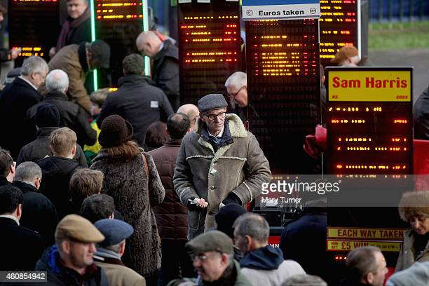 A bookmaker braves the cold during Day 2 of the Winter Festival Race Meeting at Kempton Park on December 27 2014 in Sunbury England Temperatures...