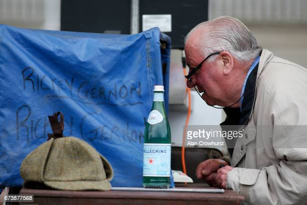 A bookmaker checks his computer screen at Punchestown racecourse on April 27 2017 in Naas Ireland