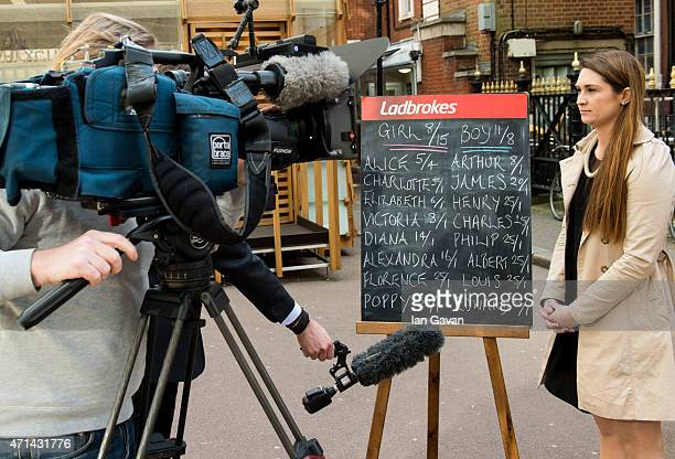 A bookmaker displaying the odds on Royal baby names is interviewed by a television crew outside the Lindo Wing at St Mary's Hospital on April 28 2015...