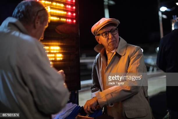 Bookmaker John Henwood works at Wimbledon Greyhound Stadium on March 25 2017 in London England Wimbledon Stadium hosts its final night of greyhound...