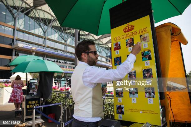 A bookmaker marks the odds for the colour of the Queen's hat on a board at Royal Ascot 2017 at Ascot Racecourse on June 21 2017 in Ascot England The...