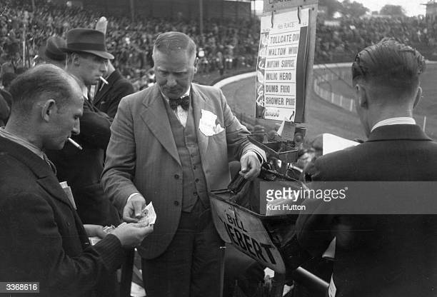 A bookmaker taking bets at a British greyhound track