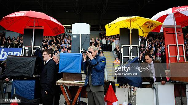 A bookmaker watches the action at Punchestown racecourse on April 23 2013 in Naas Ireland