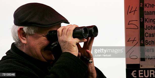 A bookmaker watches The Baileys Arkle Perpetual Challenge Cup Novices Steeple Chase Race at Leopardstown Racecourse on January 28 2007 in...