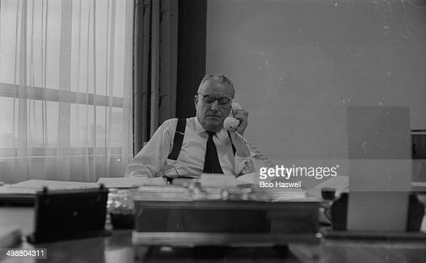 Bookmaker William Hill making a phone call at his desk to keep up to date with betting on the election October 14th 1964