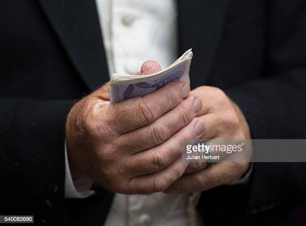 A bookmaker with part of his takings on Day One of Royal Ascot at Ascot Racecourse on June 14 2016 in Ascot England