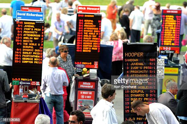 Bookmakers boards at Sandown racecourse on September 01 2012 in Esher England