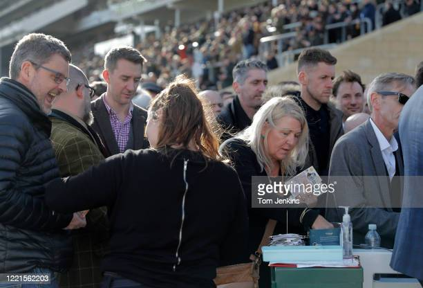Bookmakers handing out money during day four of the Cheltenham National Hunt Racing Festival at Cheltenham Racecourse on March 13th 2020 in...