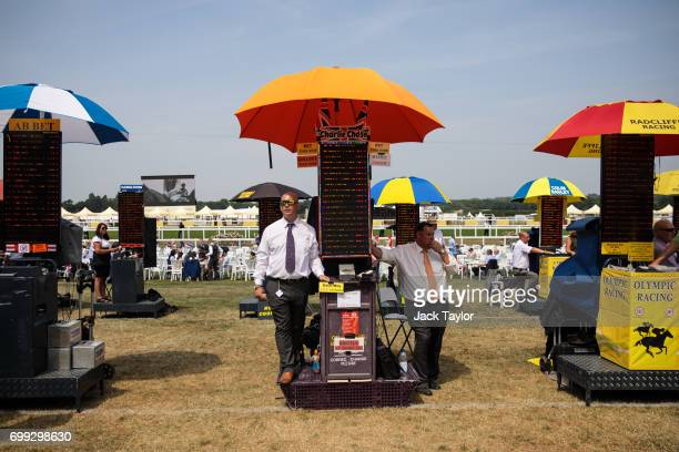 Bookmakers stand in the shade of their umbrella in the Windsor Enclosure at Royal Ascot 2017 at Ascot Racecourse on June 21, 2017 in Ascot, England....