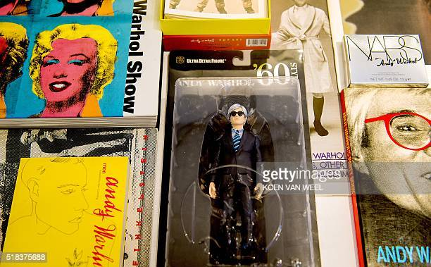 Books and a puppet of US artist Andy Warhol are displayed during the exhibition 'Warhol's World' at the Jan van der Togt Museum in Amstelveen The...