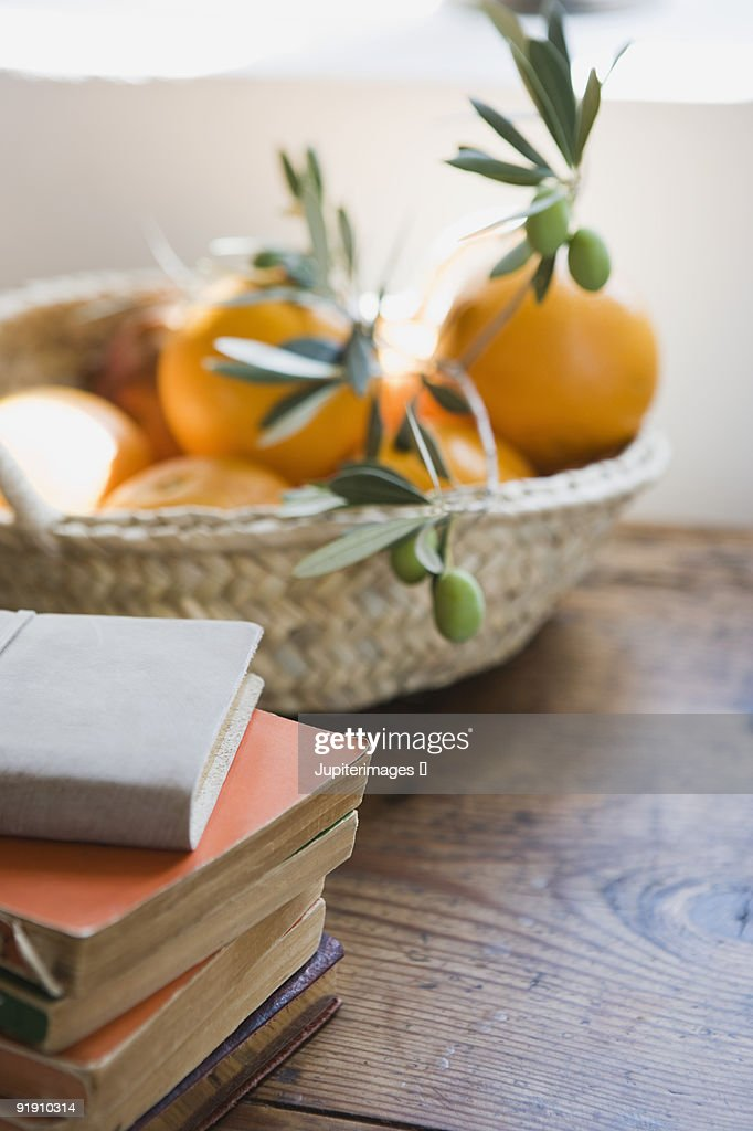 Books and basket of fruit : Stock Photo