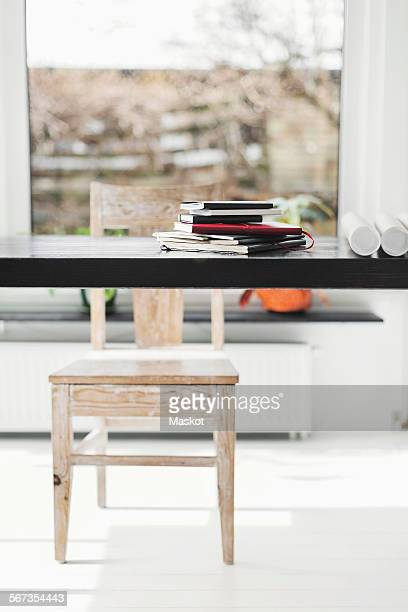 Books and blueprints on table at home office