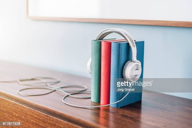 Books and headphones on wooden cabinet
