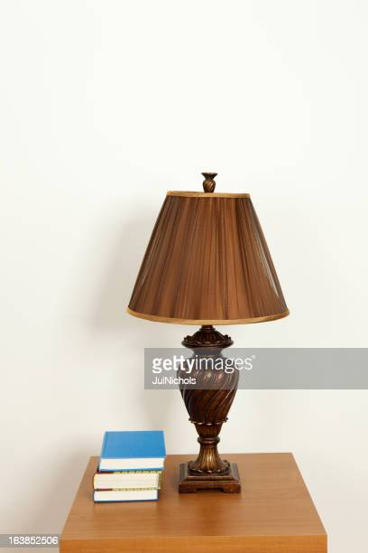 Books and Lamp on a Table