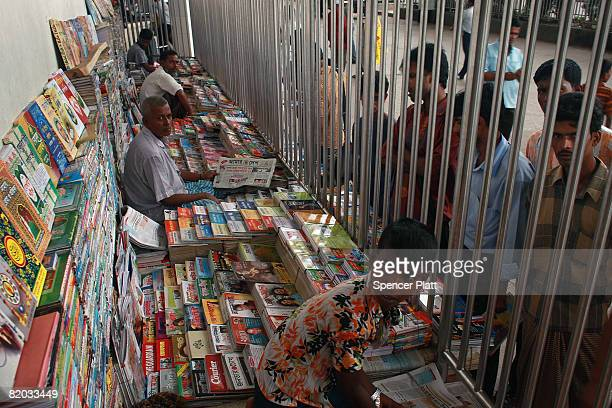 Books and newspaper vendors sell items to passengers at the Kamalapur Railway Station the largest in the country July 22 2008 in Dhaka Bangladesh As...