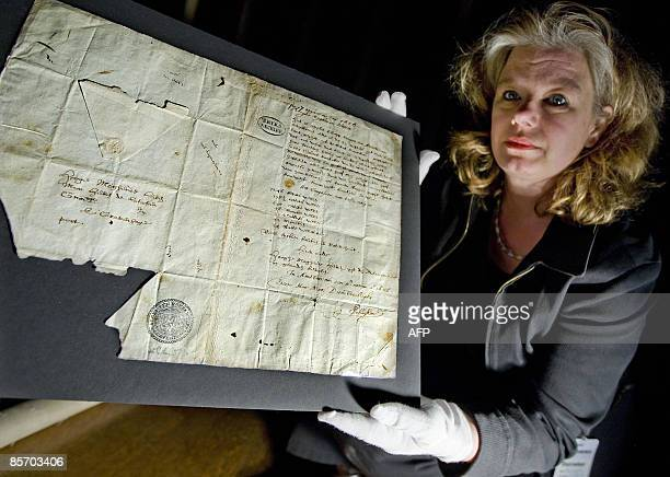 Books and paper restaurer Maartje Ubbels displays in the Rijksmuseum in Amsterdam on March 30 2009 the 'birth certificate' of the American city of...