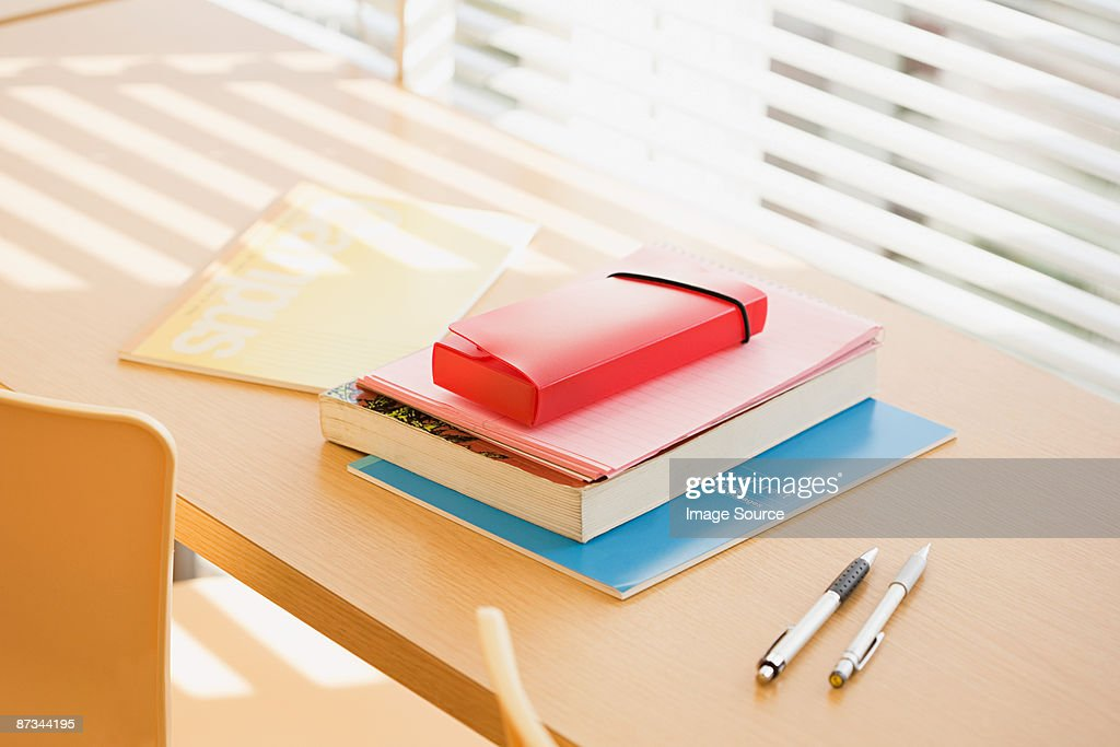 Books and pens on desk : Stock Photo